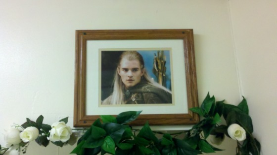 a framed picture of legolas in the girl's bathroom at this sushi place